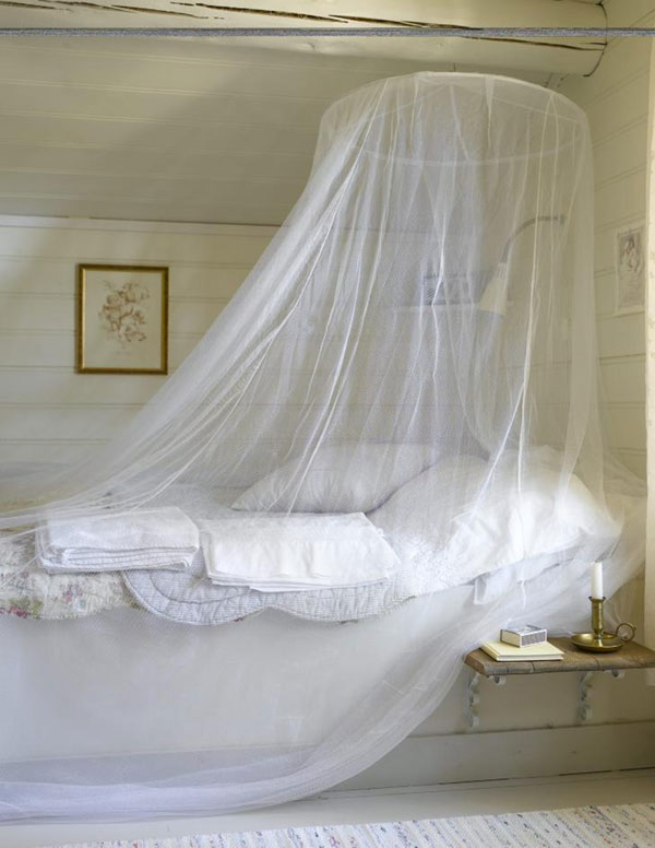 Romantic, serene, lovely (above). But the gooseneck lamp makes the whole thing look like a shower stall. Plus that candle could ignite the netting in a flash. Safety, people, especially in the bedroom, is always your friend.  Photo by Per Erik Jaeger via  here .