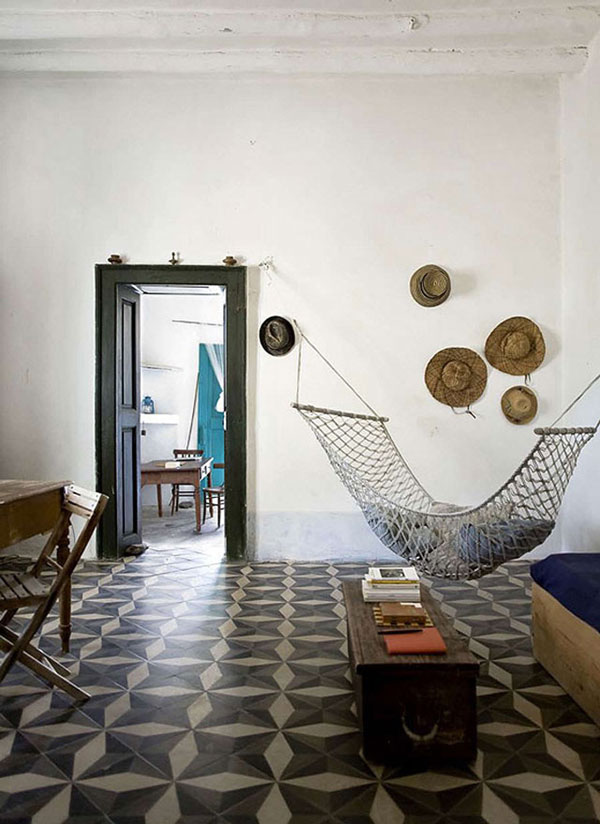 This room (above) looks enticingly moody. But on second glance, I realize it is a chic version of my old boyfriend's fraternity room. Thus, we are not surprised to note that the hardware securing the adorable hammock is flimsy -- for my weight, anyway.  Photo by Danielle de Lange.