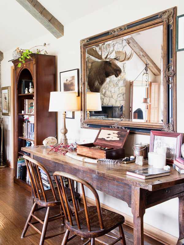 A living desk, filled with a constantly changing display of natural curiosities and that wonderful moose reflected in the mirror.