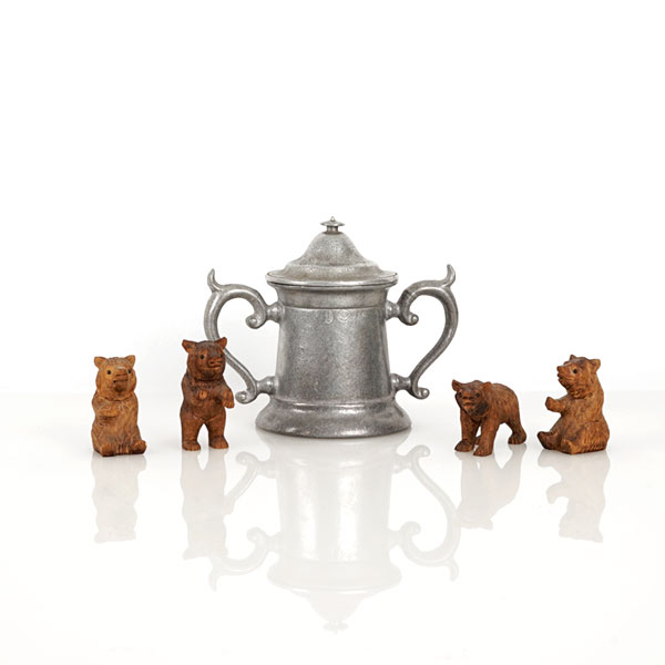 Who knows why miniature Black Forest bears gathered around a tiny pewter stein remind me of Peg. But they are hand-carved, antique, and their wee glass eyes are beady like Vlad's. Click on photo for shopping details.