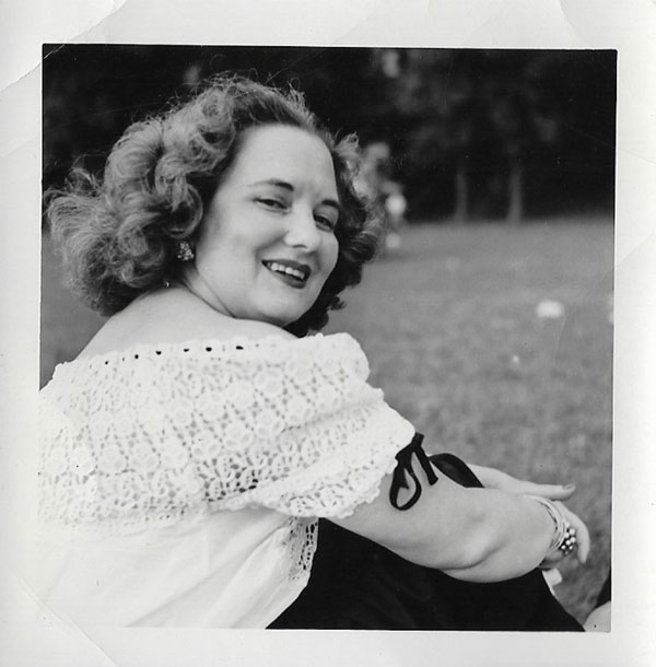 Violet VanDoren Eliason, Melody's grandmother, wearing white eyelet trimmed with black grosgrain ribbon, dangly earrings, an armful of bangles, and a beautiful smile. She had style!