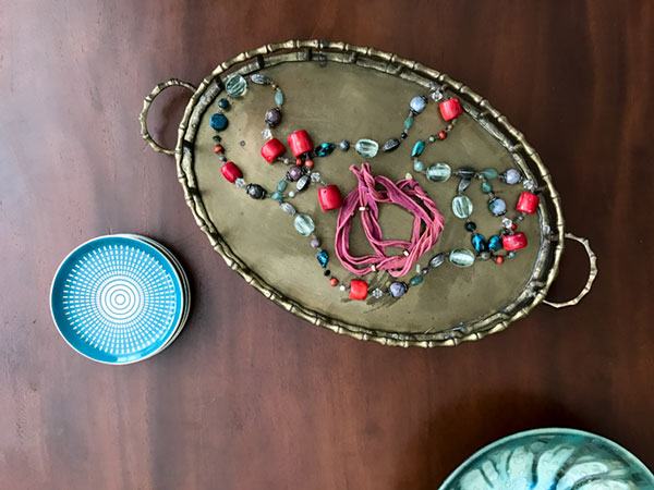 One of Margaret's original Bhati Bead wraps. This one is strung with tiny brass nuts -- a reference to her father who once manufactured them.