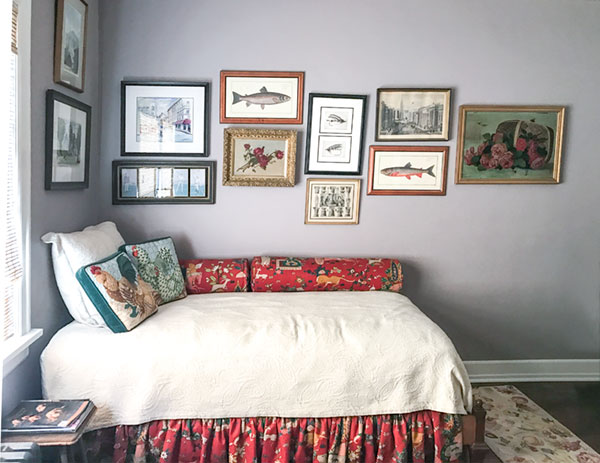 Margaret's husband Bill is an avid fly fisherman. This cozy guest room, with a gallery wall of fish engravings and a whimsical hunt fabric on the bed,pays homage to his love of The Great Outdoors.