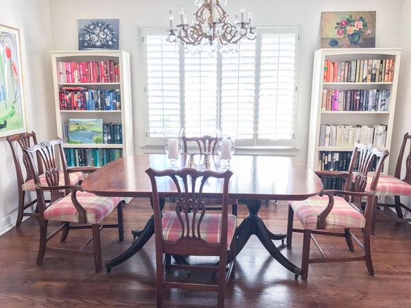 A dining room doubling as a library, which is as it should be. Also, Margaret sorts her books by color, a fun trend that causes pain to certain individuals who prefer their books sorted by author. To them I say it won't kill you to browse through your own stacks.