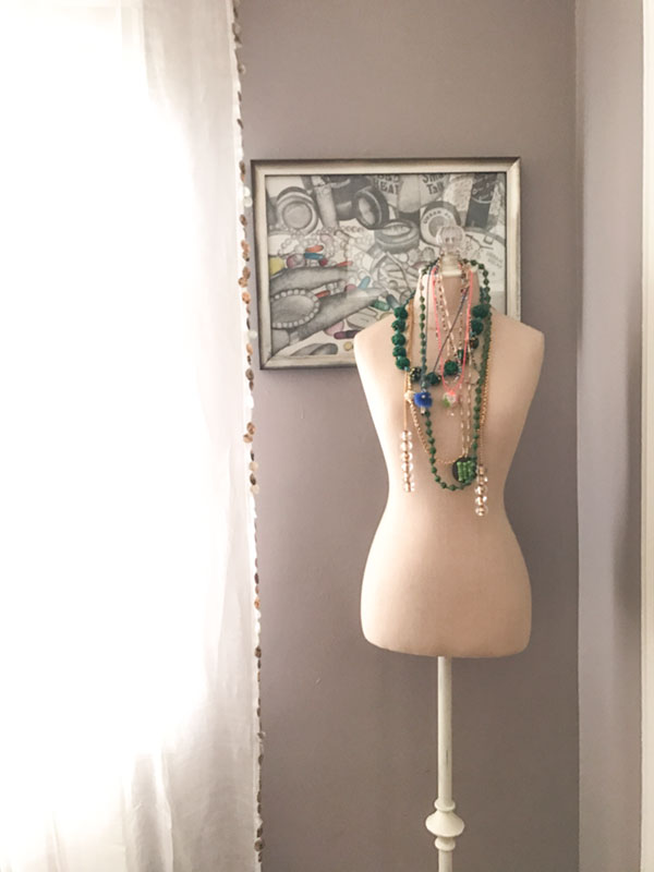 A dress dummy draped in a collection of interesting vintage beads. I have several of Margaret's designs and my favorite is a wrap with a tiny Tibetan prayer box.