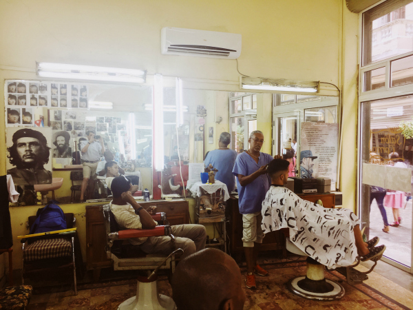 A barbershop visit is always on George's agenda and this place was a popular hangout for men just killing time. Throughout Cuba, the normal Latino warmth is further baked by the Caribbean sun, spiced with a bit of naughtiness, and then simmered with an insatiable curiosity about all things American.   E  veryone on the island seems to have a cousin in New York or an aunt in Miami, and everyone wants to talk to you.