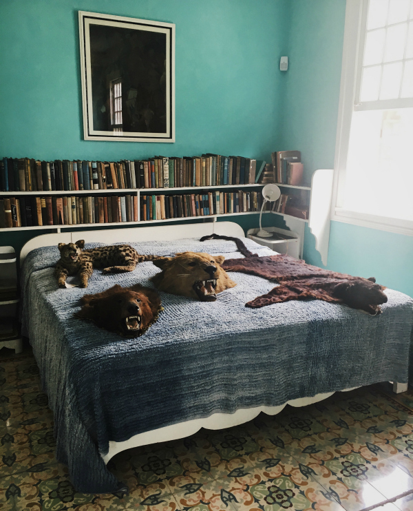 """Hemingway's home is full of African game trophies, but one can only imagine what human creatures he took pride in slaying atop this mattress. He went through two wives and who knows how many mistresses at Finca Vigia, which translates to """"lookout farm""""."""