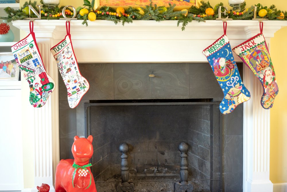 These stockings were needlepointed by Kathy, the devoted grandmother of Chase, Tucker, Beecher, and Jack. Each stocking took a year to complete.