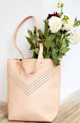 Cold Picnic Perforated Tote Bag A leather + brass carryall for all your daily needs: spacious enough for your market purchases, library books and yoga gear. Did we mention it's gorgeous?