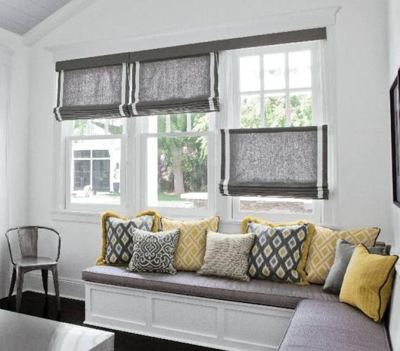 Window treatments help distract from the busy street.