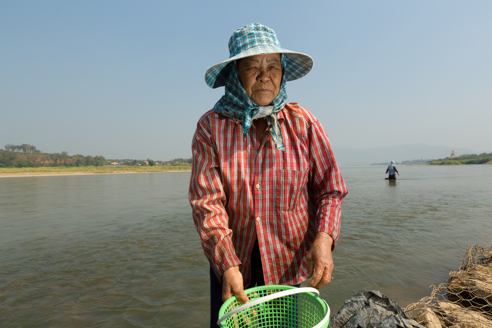 Khun Jan Fong on the banks of the Mekong River at Chiang Khong, Thailand. February 2016.
