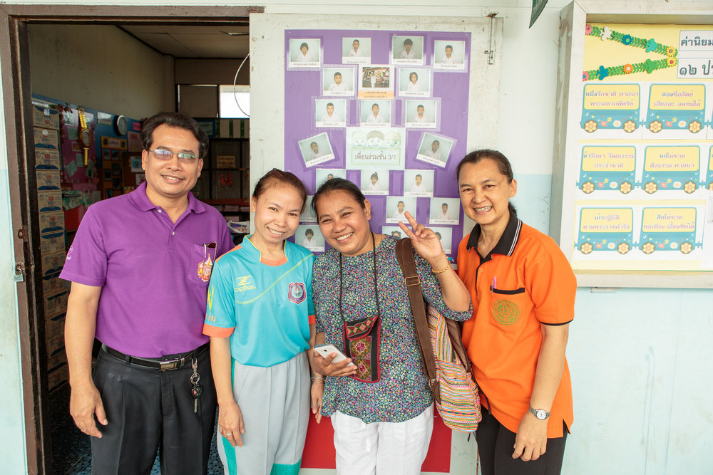 Wandee talks with a few of the teachers who now work at her primary school.