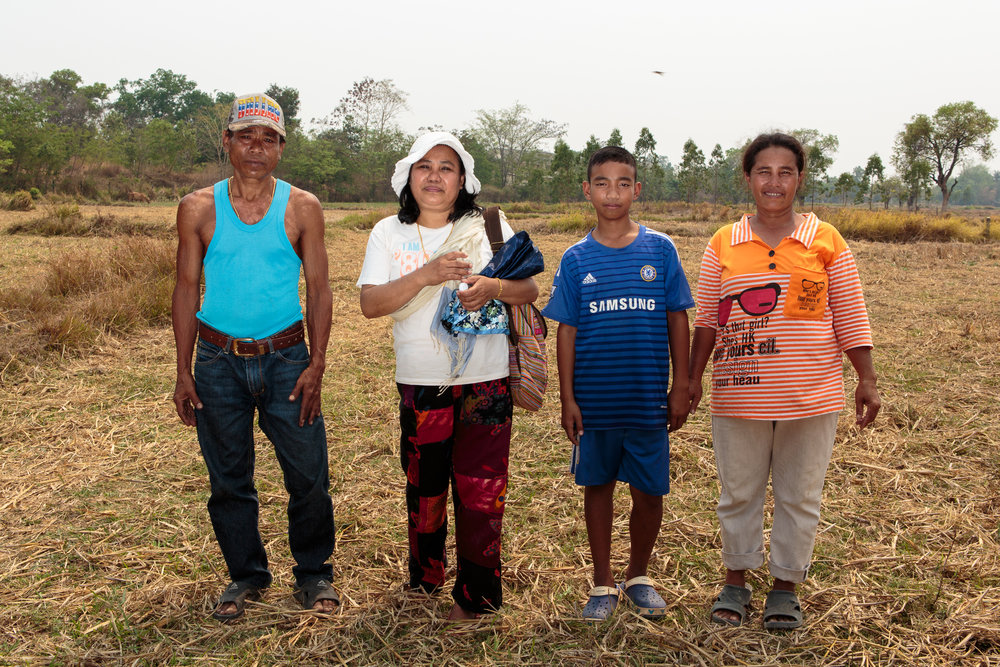 Wandee with her brother Chai, her nephew Gong and Chai's wife Mot, on the original family farm. Wandee bought a parcel of the land some years ago, and Chai farms it for her.