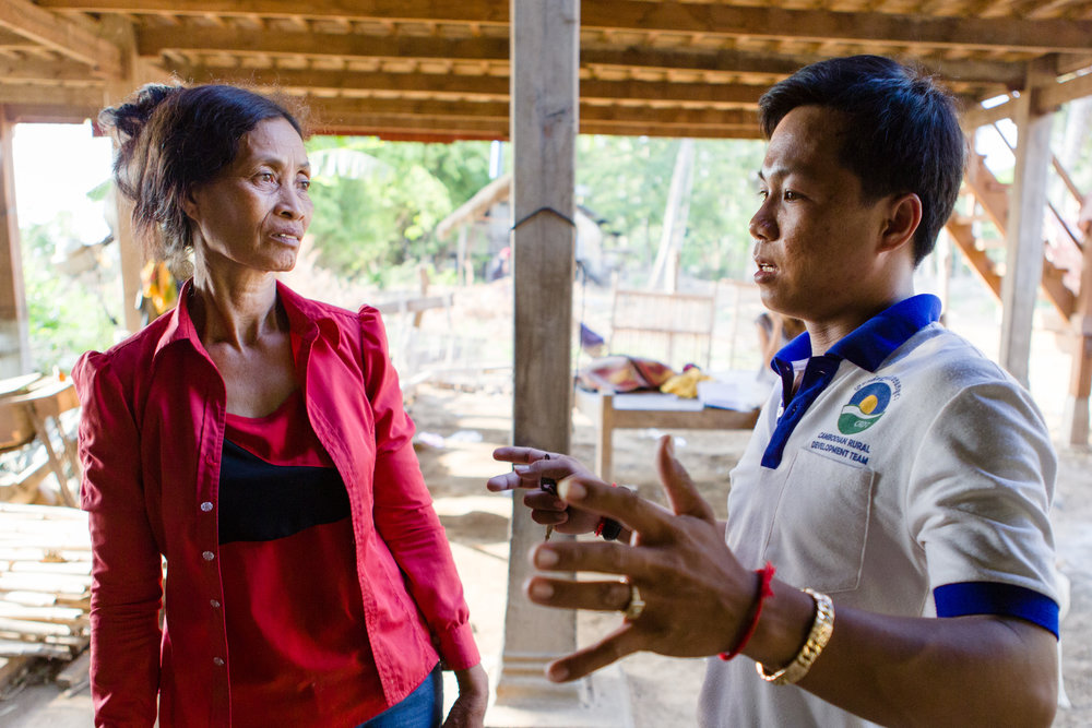 Koeuniyi talks with Phynal,  a staff member of the Cambodian Rural Development Team, the NGO that helped to start her micro-finance group.