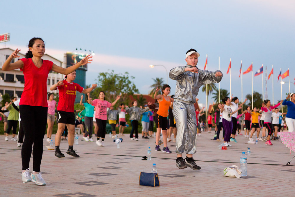 Hundreds of people take part in daily aerobics on the Mekong river front in Vientiane.