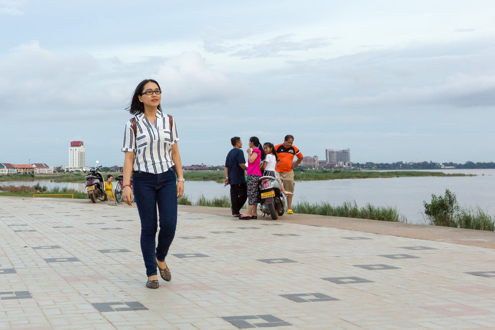 Palamy Changleuxay walks along the Mekong in Vientiane.