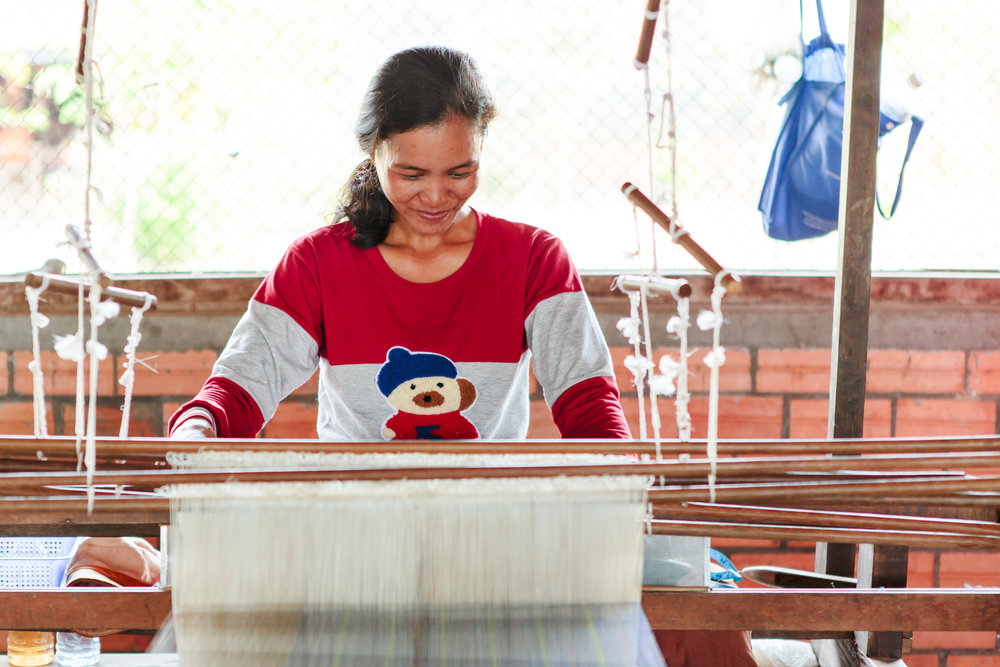 One of the women who works as a weaver at Mekong Blue.