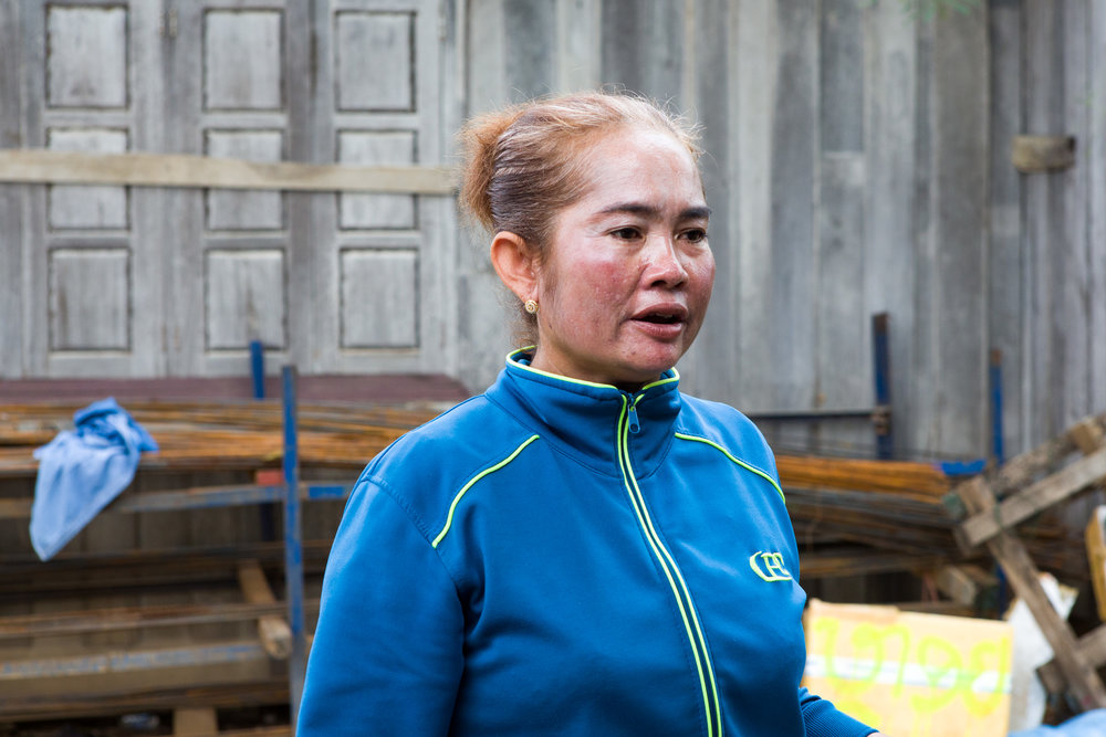Mrs. Wan coordinates fish orders with markets and restaurants in other centres and arranges for fish to be sent to them on small delivery trucks.