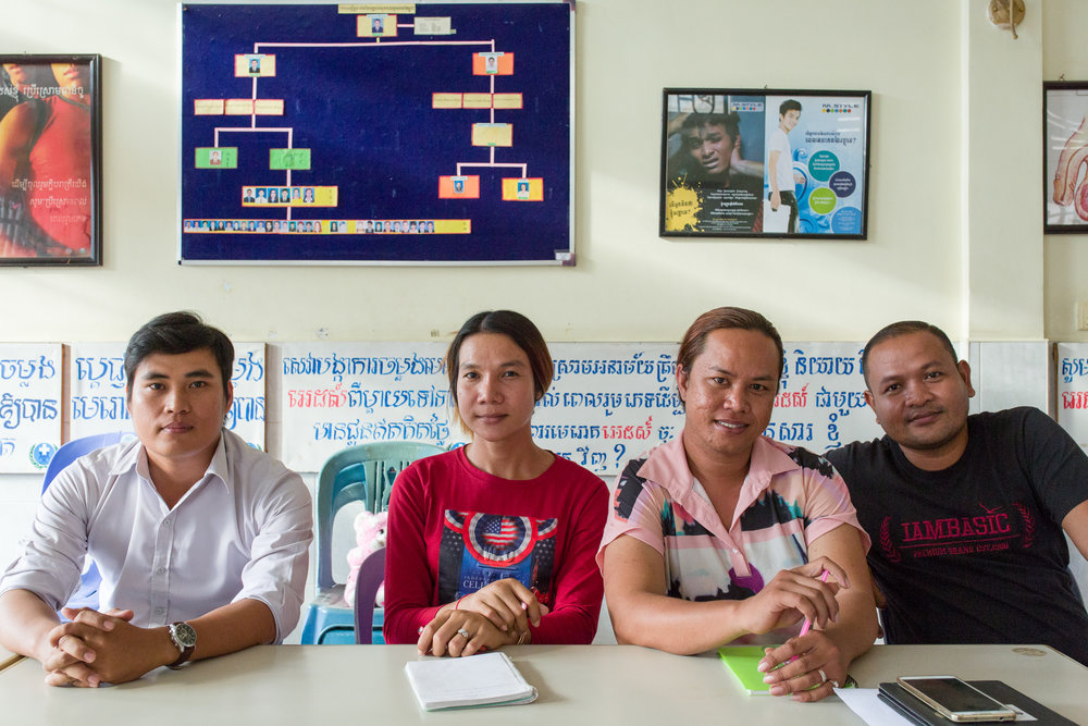 With some of their colleagues at the Men's Health Centre in Phnom Penh.