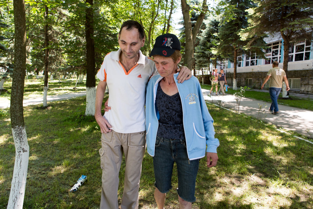 "Ludmilla helps her friend Sergei to walk. They both had TB, and stood by one another as they finished their treatment. ""When you're sick and alone, the support is so important."""