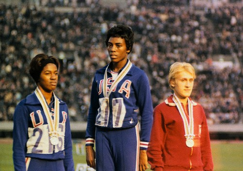 During the Mexico City games in 1968, Wyomia Tyus faced an atmosphere of racial tension. African American athletes threatened to boycott the games.    Although the boycott never occurred, two sprinters, bronze medalist John Carlos and gold medalist Tommie Smith, were suspended from the U.S. team for raising a Black Power salute during their victory ceremony. For Tyus the 1968 games were personally and professionally important. She won gold in the 100-meter dash for a second consecutive time, something no one else did until Carl Lewis competed twenty years later, and she also proved herself the fastest woman in the world for a second time. In response to the suspension of her fellow athletes, Tyus's 400-meter relay team, which won the gold medal and set a new record, dedicated their medal to Carlos and Smith.