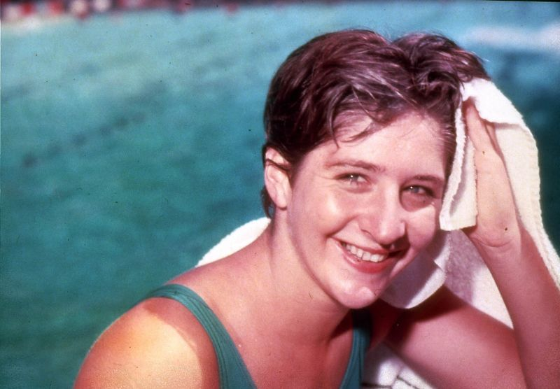 Dawn Fraser is regarded as the finest female sprint swimmer of them all; winner of four gold and four silver Olympic medals, holder of 39 world records. Just six months before the 1964 Tokyo Olympics, Fraser was driving a car when it crashed. Her 60-year-old mother, Rose, who had been sleeping in the backseat, was killed. she went to Tokyo in 1964 and won her third consecutive gold medal for her late mother. Wearing her mother's wedding ring, she stood by the pool and sobbed. Then she started blasting on a bugle while poolside, marching at the wrong time, and trying to steal a flag from the Emperor's palace (a jailable offence). The Japanese authorities and Australian public forgave her (she was made Australian of the Year in 1964), but, in a very unpopular move, the Australia Swimming Union banned her from swimming for a decade. Fraser has since remarked that she was banned for wearing a comfortable but unofficial swimsuit (that she had stitched herself) in the Olympic opening parade and one of her heat races, because the official uniform swimsuit was ill-fitting. She now co-manages a cheese shop and pub with a woman with whom she has been in a long-term relationship.
