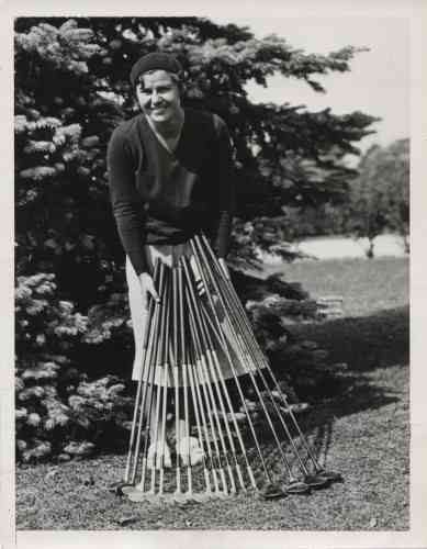 Helen Hicks displaying her collection of golf clubs appeared as part of a magazine feature titled, 'Clubs Used by Outstanding Women Golfers.' The uncredited image is from The American Golfer magazine's January 1931 edition. Hicks was one of the first professional women golfers, when she became a pro in 1932. Hicks was also a founding member of the LPGA.