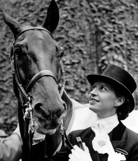 A seven time Danish dressage champion, Hartel contracted polio at age 23 while pregnant with her second child. Despite being paralyzed from the knees down, Hartel ignored the advice of her doctors and spent three years regaining the use of her limbs and re-learning the sport. In 1952, she became one of the first women to compete against men in Olympic equestrian events, winning a silver medal.  Still suffering the effects of polio, Hartel was unable to mount and dismount on her own - gold medal winner Henri Saint Cyr carried her to the podium for the medal ceremony.  After retiring, Hartel trained young Danish riders and founded Europe's first therapeutic riding center.  In 1994, she became the first Scandinavian inducted into the International Women's Sports Hall of Fame.