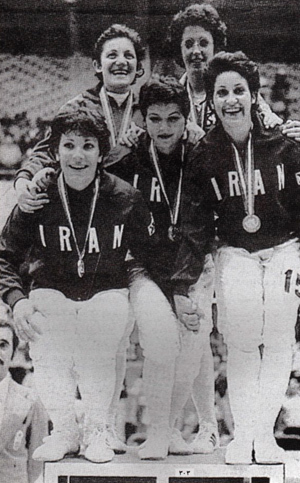 "Photo: The 1974 Iranian women's fencing team, winners of the gold medal at the 1974 Asian Games. To date, this is the only gold medal Iranian women athletes have won in international competition.   Prior to the Iranian Revolution in 1979, female sports centres and teams had begun to be established throughout the country.  The Taj Recreation Centre became the first club to train women.  As Batool Bagheri, one of the first Iranian football players, described it ""in 1970, after a long struggle, we found a place where we could hold our practices. Before that, we sometimes played without husbands and brothers in the alleyways, but in 1970 we gained official permission to, without men, practice on a real field."" When the new Islamist government took hold in 1979, women's sporting competitions were disbanded for several years. When they were reinstated in 1981, veiling of all female athletes was made mandatory and gender segregation rules meant that women coaches, referees and managers would need to be trained before women's sporting events could be reinstated. It would not be until 1990 that Iranian women would compete internationally again."