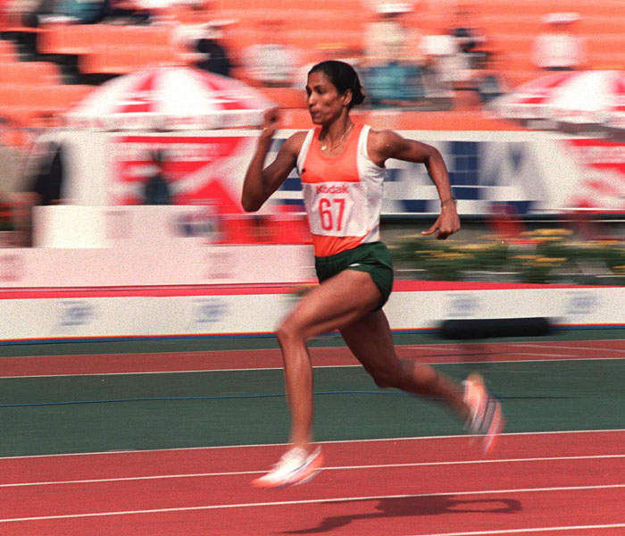"The ""queen of Indian track and field"", Usha became the first Indian woman to reach the final of an Olympic event when she made the 400 metres hurdles final at the 1984 Olympics.  In a heartbreaking photo finish, Usha missed the bronze medal by 1/100th of a second, although her time still stands at the Indian national record in the event.  Winner of ten medals at the Asian Games, Usha was named the Best Athlete in Asia four years in a row and Sportsperson of the Century by the Indian Olympic Association.  In her home state of Kerala, Usha established the Usha School of Athletics to help young athletes achieve excellence in a range of athletic pursuits.  One of Usha's pupils, Tintu Luka, recently qualified for the 800m semi-finals at the 2012 Olympics."