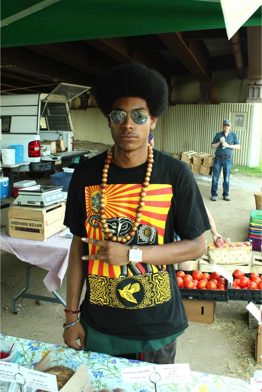 Ayinde at the Brookland farmer's market. Copyright Will Allen-DuPraw 2014