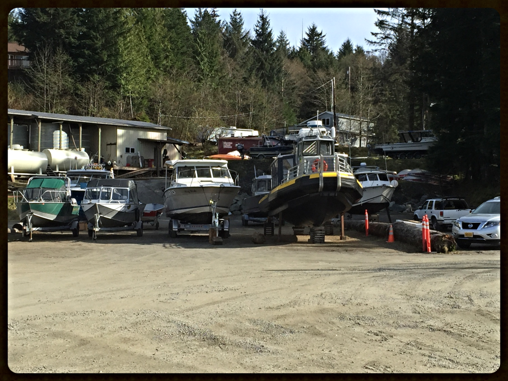 Sign of Spring... boats getting ready in parking lot.