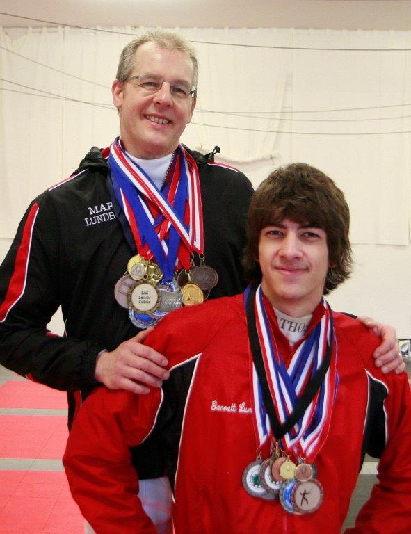 WFA saber coach and veteran competitor Mark Lundborg with son and WFA instructor Garrett Lundborg.