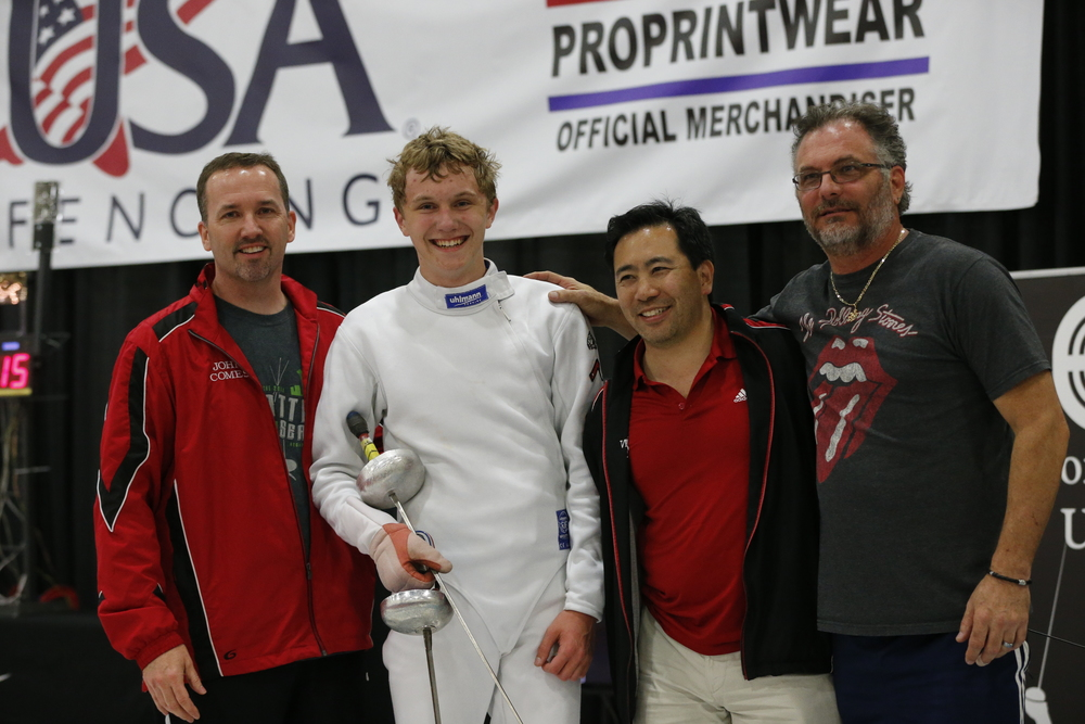 Matthew and members of his WFA support team (L-R): Proud dad John Comes, (Matthew), coach Kevin Mar, and senior coach Bill Becker.
