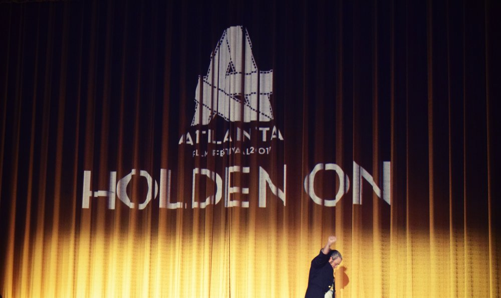 "Writer/Director and IAMHOLDENON Founder, Tamlin Hall, accepts the Best Feature Audience Award for ""Holden On"" at the 42nd annual Atlanta Film Festival."
