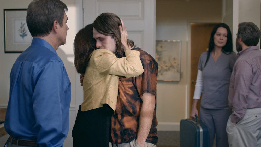 Mom hugs Holden goodbye.jpg