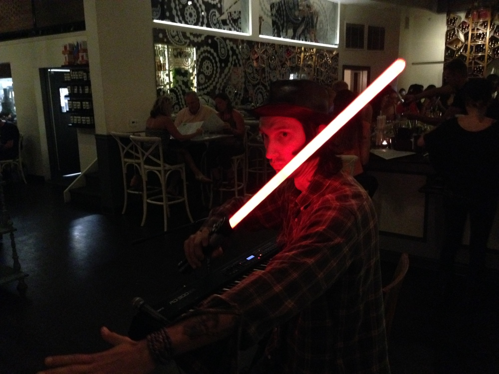 The force is strong with this one. Joe Guevara, keyboardist in Lady Dottie and the Diamonds, wielding his light saber. Joe has real Comic-Con street cred., having attended the old Comic-Con back in the day at San Diego's Golden Hall