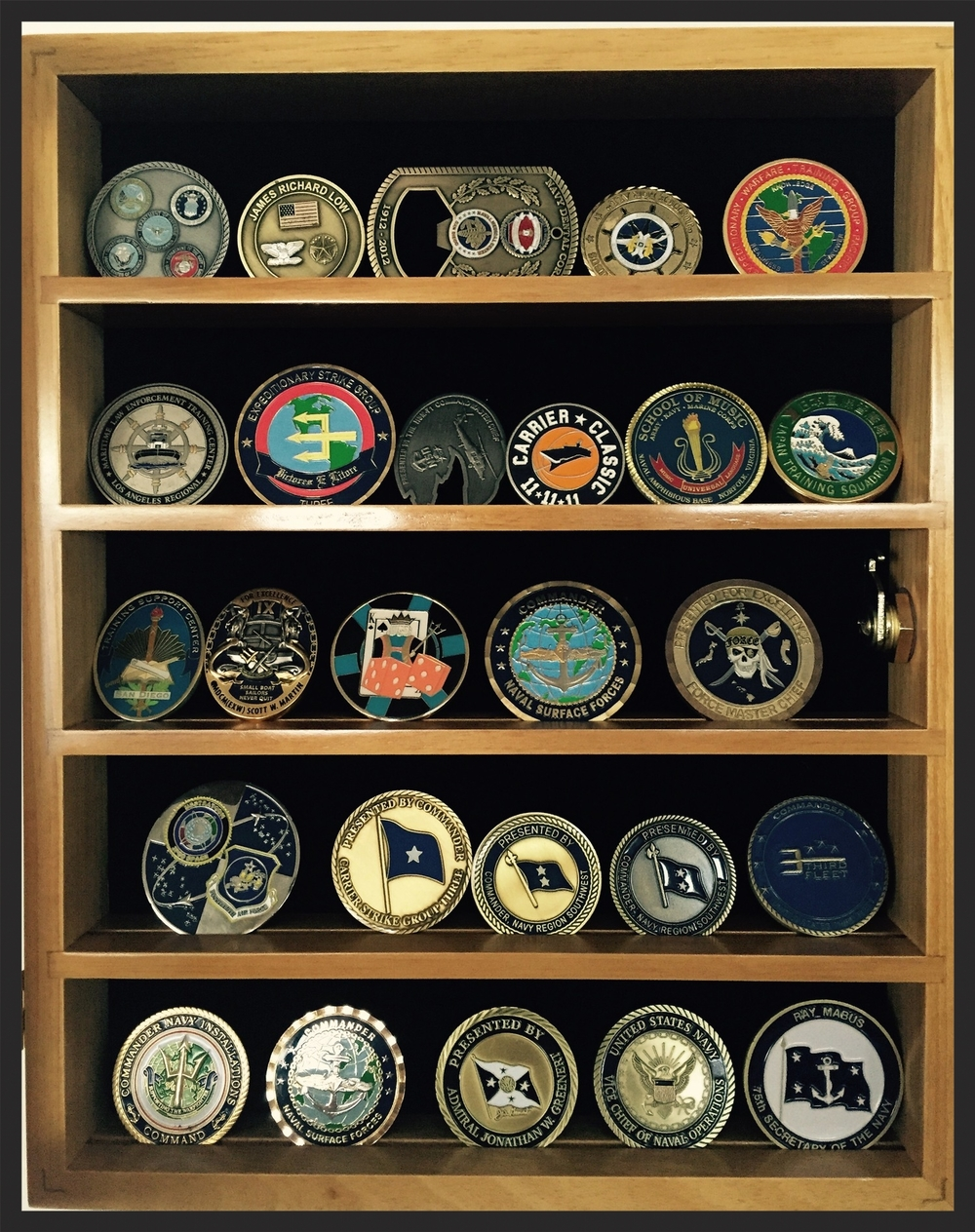 26 challenge coins, proudly displayed at my home in San Diego, CA.