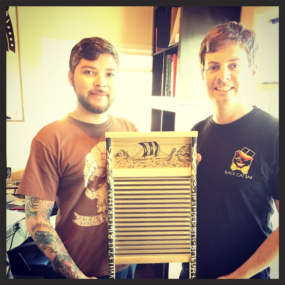 Artist Jerry Villalobos holding my new washboard with me at the Red Crow. San Diego, CA, 2015