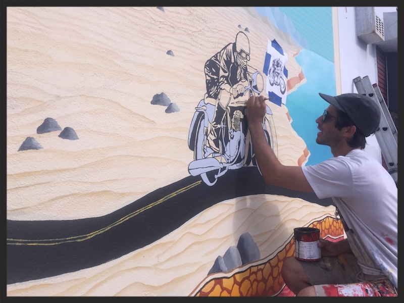Jonny Alexander working on the (now complete) mural, located at the corner of El Cajon Blvd. and Winona Avenue. Photo by Anders Larsson, 2015