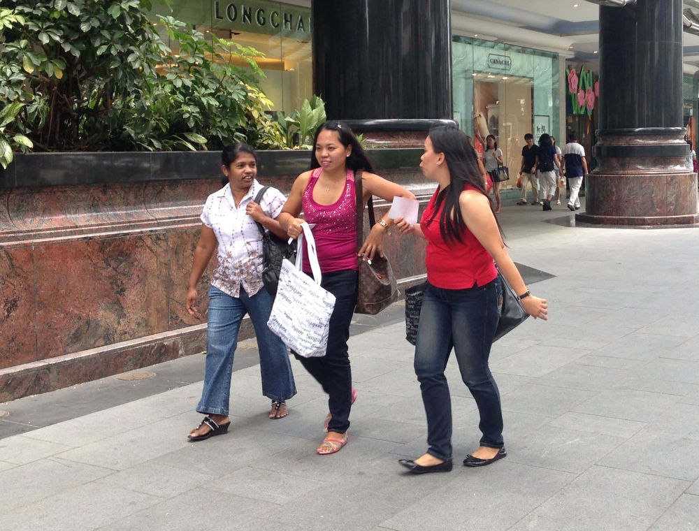 On Sundays the domestic helpers meet their friends on Orchard Road.