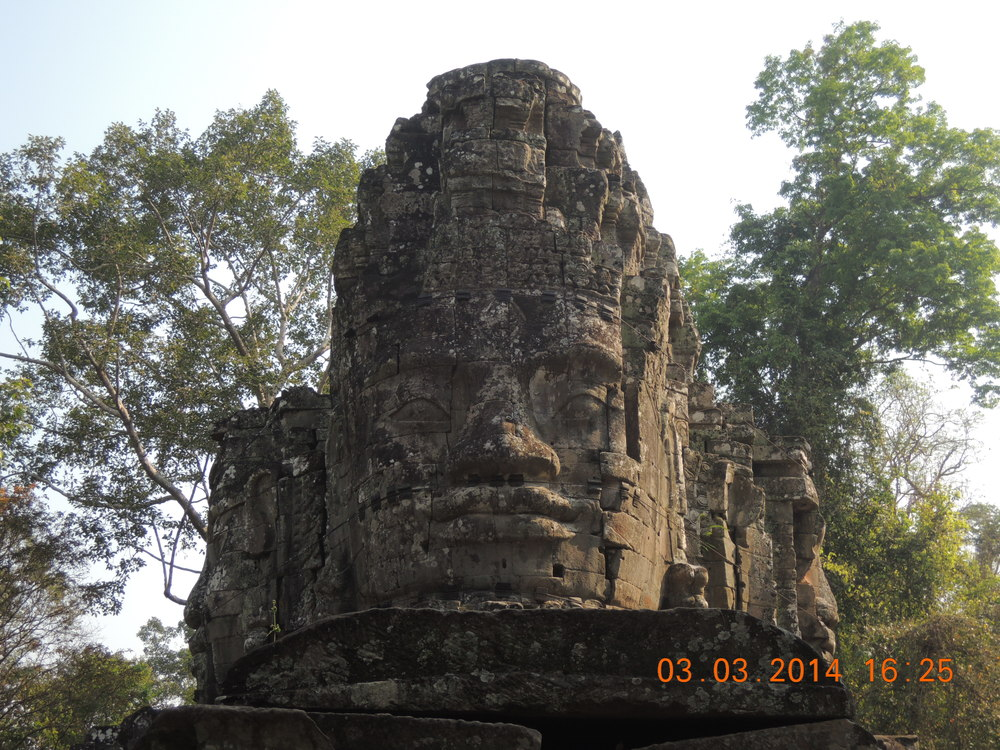 Buddahs pop up everywhere in the Angkor Zone.