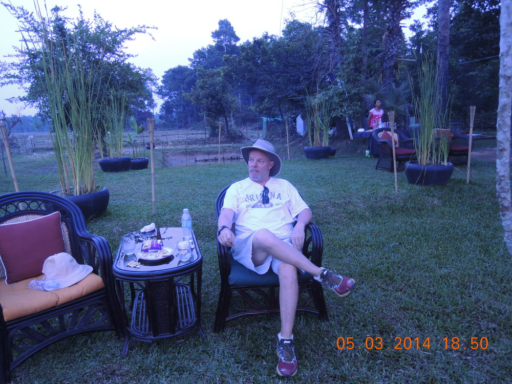 David having a gin and tonic at the end of our day in the Cambodian countryside.