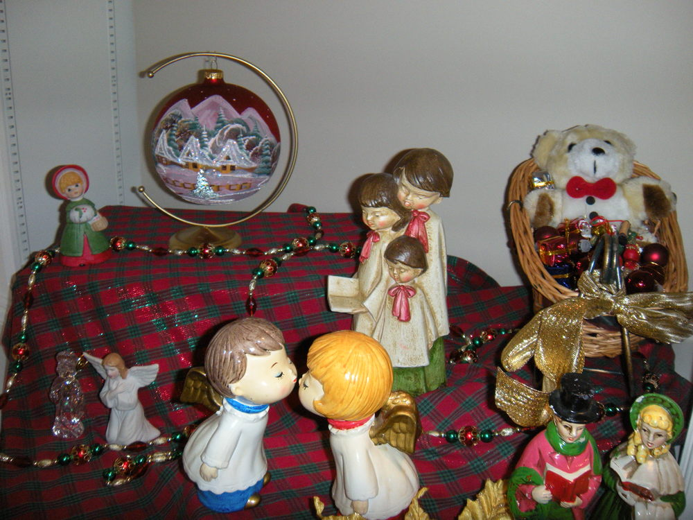 The carolers and kissing angels are very old.  They belonged to my mother's second husband's first wife.  .