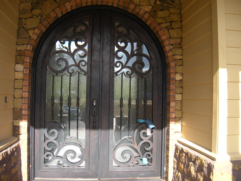 Isn't this a beautiful front door? You can't tell by looking, but that's wrought iron, not wood.