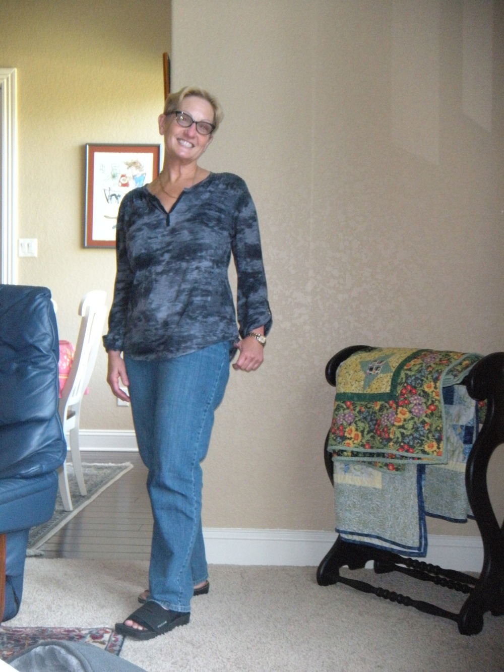 Me on a fallow day.  No make-up or earrings, baggy jeans.  See the boot--toe still broken.
