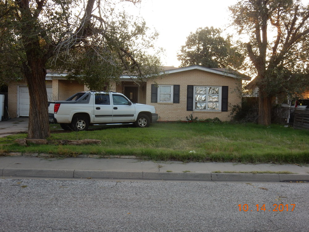 My childhood home. Can you see the refrigerator on the left? The truck is nice.