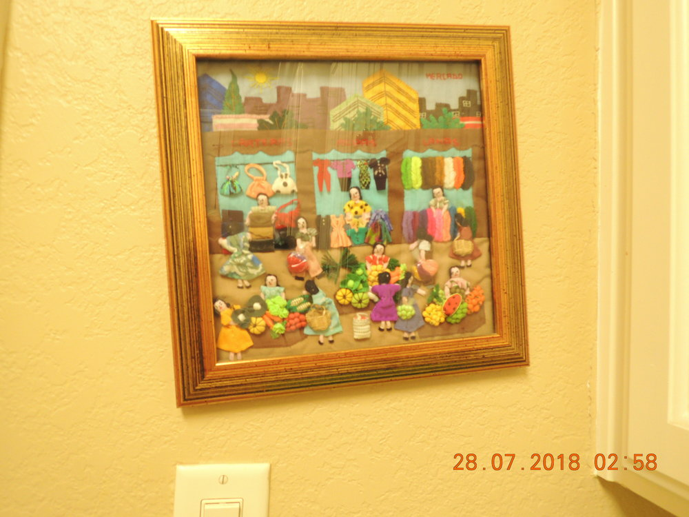 "Because it's just above the light switch, this little ""Mercado"" picture often gets knocked askew. If it's not a right angle it's a wrong angle!"