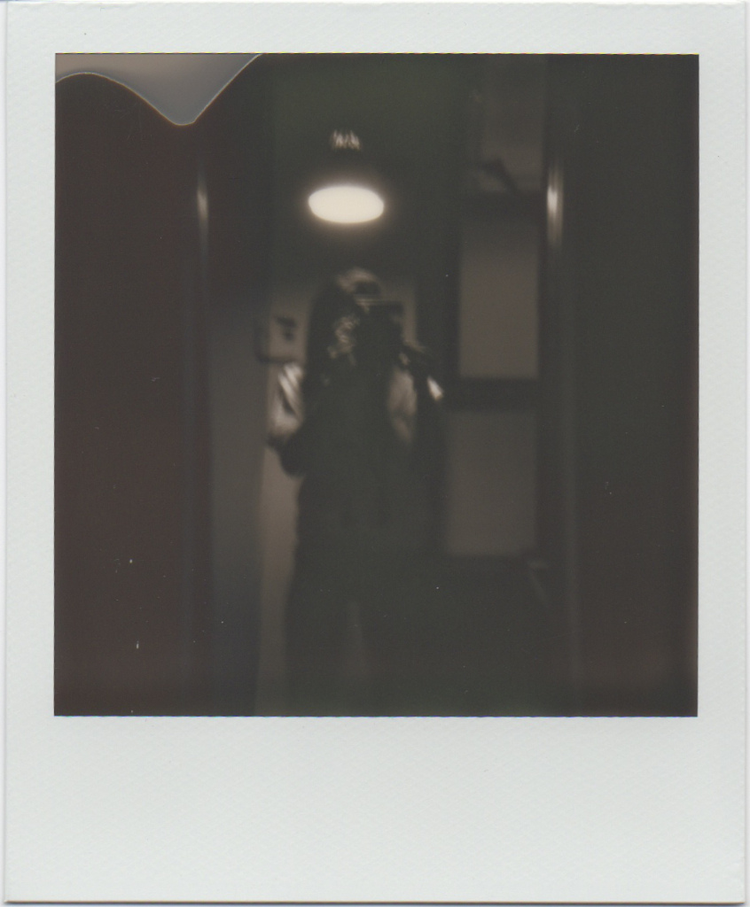 Self portrait.  3rd instant shot I ever took, the other two were just blobs.   Model/Photographer:  Gracie Hagen