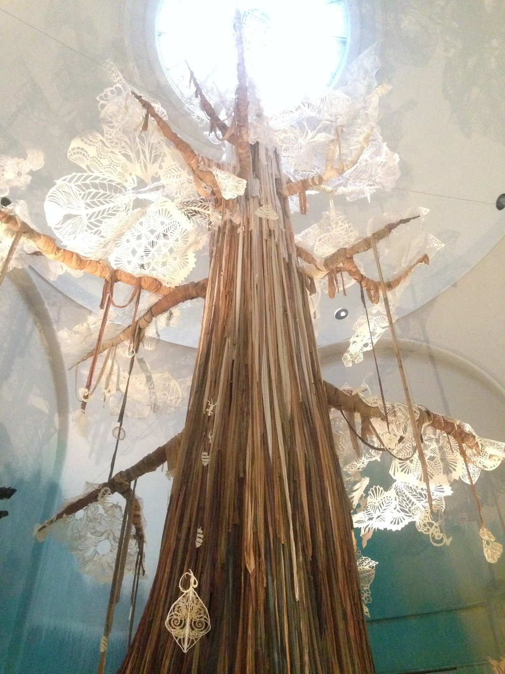 RAG INFUSED TREE TRUNK WITH REFLECTED FORMS BY SWOON